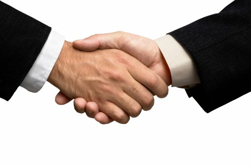 handshake  behind a solid white background